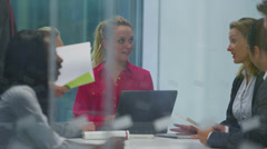 Attractive young business team in a meeting in modern city office.  - stock footage