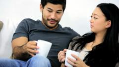 Happy Asian Chinese Couple Home Couch Mugs Hot Coffee Stock Footage