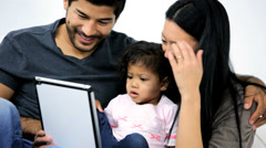Little Ethnic Girl Playing Digital Games Parents Wireless Tablet - stock footage