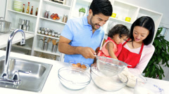 Ethnic Parents Infant Daughter Baking Together Kitchen - stock footage