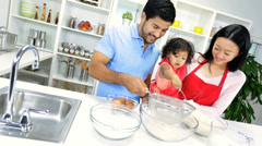 Happy Young Ethnic Family Home Kitchen Cake Baking - stock footage