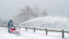 Snow blower removes snow from road in the park. Stock Footage