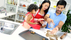 Ethnic Parents Infant Daughter Baking Cookies Together Kitchen - stock footage