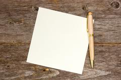 Stock Photo of empty note paper with pen
