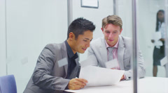 Businessmen interviewing job applicant in modern city office.  Stock Footage