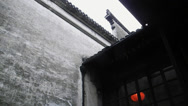Stock Video Footage of raindrop falling down in the front yard of a Chinese house