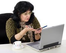 Teacher uses her laptop online Stock Photos
