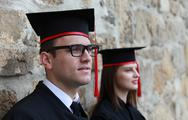 Stock Photo of Young Couple in the Graduation Day
