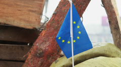 European Union flag on protesters' barricade in Kiev Ukraine, click for HD Stock Footage