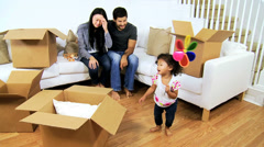 Happy Asian Chinese Family Surrounded Home Moving Cartons - stock footage