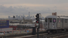 Metro train pass panoramic New York cityscape cloudy day skyline commuter NYC US Stock Footage