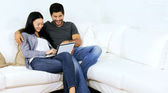 Happy Asian Chinese Couple Touch Screen Tablet Websites - stock footage