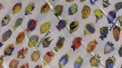 Maldives - souvenir foulards on a wall Stock Footage