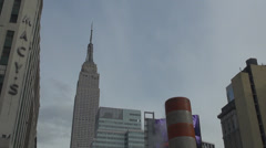 Empire State building steam vapor red white stack tube day urban New York City Stock Footage