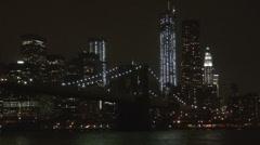 Brooklyn Bridge Freedom Tower business block night light skyline New York USA US Stock Footage