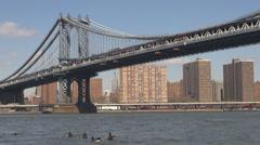 Brooklyn bridge skyline Empire State building suburb Hudson River New York City  Stock Footage