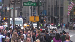 Tourist commuter people walk sidewalk travel avenue traffic car day New York US Stock Footage