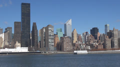 Panoramic Manhattan skyscraper business block sunny day East River New York USA Stock Footage