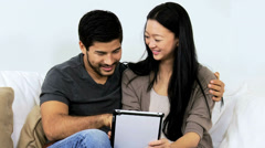 Relaxed Ethnic Couple Tablet Wireless Internet Websites - stock footage