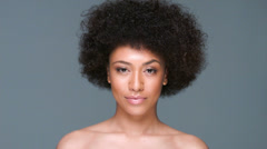 Beautiful woman clutching her afro hairstyle Stock Footage