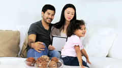 Relaxed Ethnic Couple Baby Girl Tablet Wireless Internet Websites - stock footage