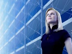 Attractive blonde standing by the skyscraper Stock Photos