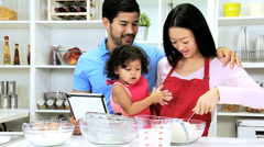 Happy Young Ethnic Family Wireless Tablet Home Kitchen Cake Baking - stock footage