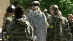 Paintball pause, players will confer. Stock Footage