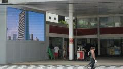 People walking in front of a gas station. Santos, Sao Paulo, Brazil. 87 Stock Footage