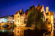 Stock Photo of river canal and medieval houses at night, bruges