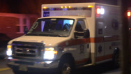 Stock Video Footage of Ambulance Driving By Transporting A Patient To The Hospital