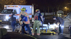 Fire & Rescue With Medics Transporting A Patient To An Ambulance - stock footage
