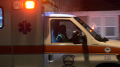 Ambulance Leaving Scene Of A Crash Transporting A Victim To The Hospital - stock footage
