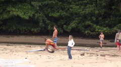 Surfers exercising on beach Stock Footage