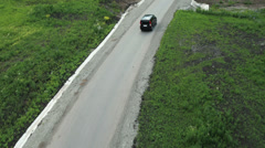 Aerial View. Car on a winding road in the hills Stock Footage