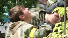 Tired Paintball players in the shelter Stock Footage