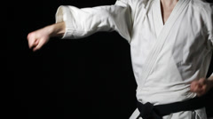 Strong punches in the performance of an athlete in a white kimono Stock Footage