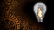 Stock Video Footage of Flaming Light Bulb with Gears