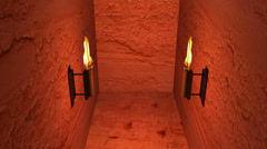 Torches inside tomb interior Stock Footage