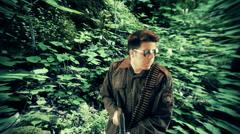 Viet nam solder tracking through forest Stock Footage