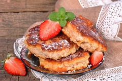 pancakes with cottage cheese with strawberries - stock photo