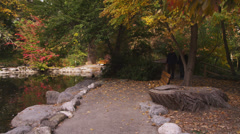 Couple Look at Pond in Lithia Park Stock Footage