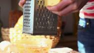 Stock Video Footage of Cook grate cheese over tasty pizza HD