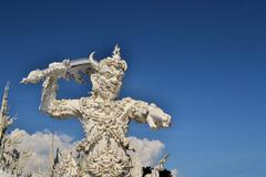 Statue from Buddhist hell, white temple, Thailand Stock Photos