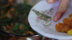 adding oregano to pan - stock footage