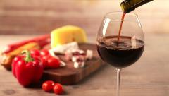 Pouring red wine and snacks Stock Footage