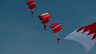 Stock Video Footage of Flying the Bahrain Flag are the The Red Devils and Saudi Falcons Parachute Team