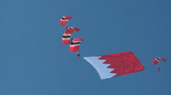 Flying the Bahrain Flag are the The Red Devils and Saudi Falcons Parachute Team Stock Footage