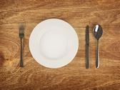 Stock Illustration of plate and flatware on wooden table