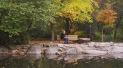 Man Meets Woman at Park Bench Stock Footage